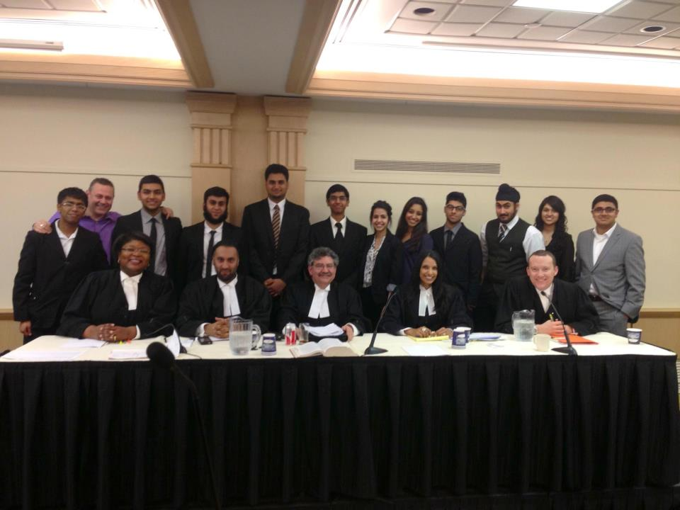 Back Row: Winning team from Middlefield Collegiate Institute Front Row, From Left: Judges for the round; Roslyn Mounsey, Omar Ha-Redeye, Gary Segal, Nimali Gamage, Justin Jakubiak